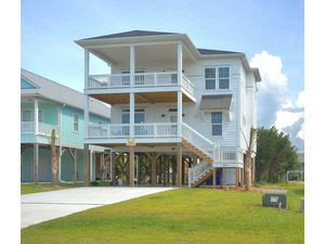 3510 E Dolphin Dr Oak Island-small-001-2-Front of Home-583x500-72dpi
