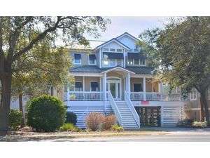 Sea Love 7303 E Oak Island Dr-small-001-30-Front of Home-666x398-72dpi