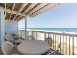 Oceanfront deck area accessible from both the living room and master bedroom.
