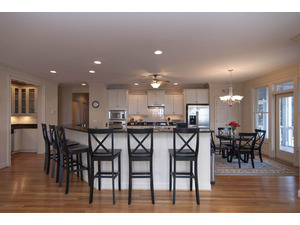 Open kitchen with bar seating, butlers pantry and breakfast area.
